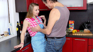 Cute teen stops cooking to fuck an old dude