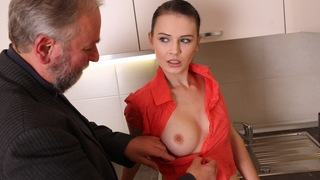 Katia shows off her erotic body in the kitchen in her pink and peach outfit. Her breasts flow in the outfit and today won't know that she'll be having an older guy for a treat.