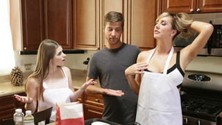 Alice March is helping her stepmom Brett Rossi as they bake cookies together while Dylan Snow watches. After declaring how hot it is in there, Brett peels her dress down to show off her full boobs and then helps Alice to slide her shirt down, too. Then sh